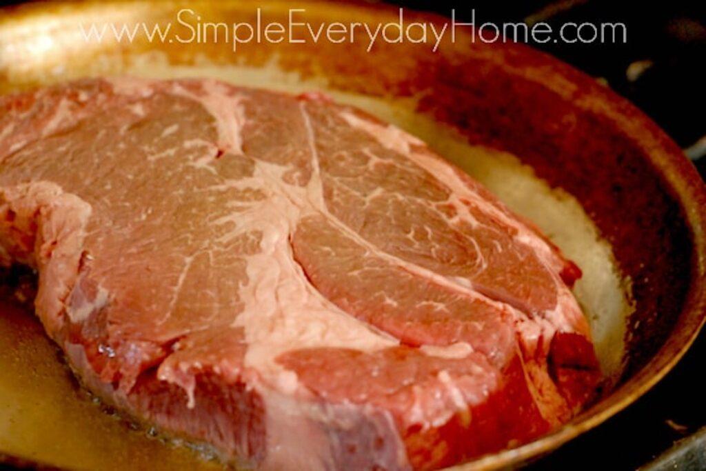 Beef roast cooking in skillet