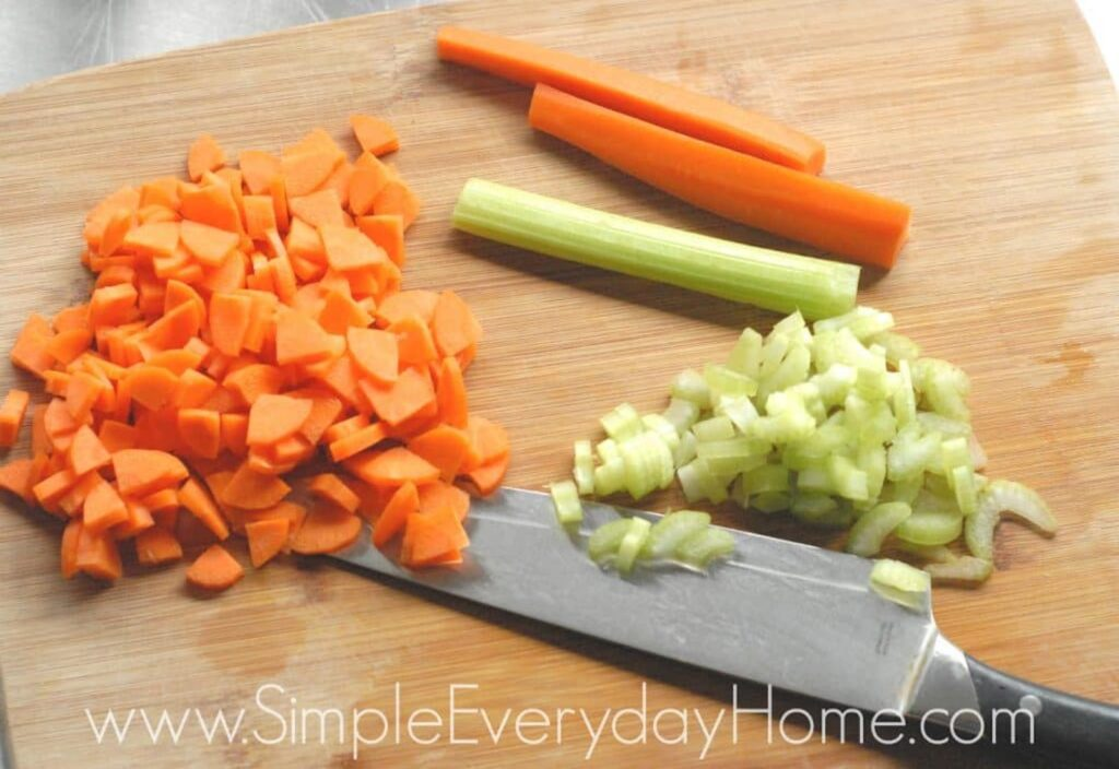 Carrots and celery diced on cutting board